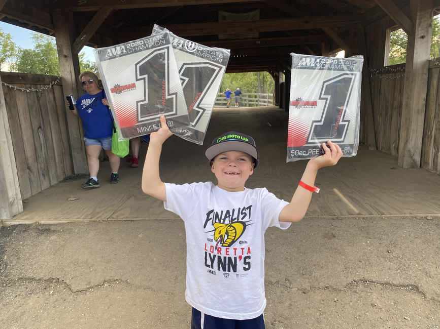 Levi Rains shows off the spoils of victory after winning the 50 Pee Wee, 50 JR classes, and the Mini-E class. Photo: Justin Rains